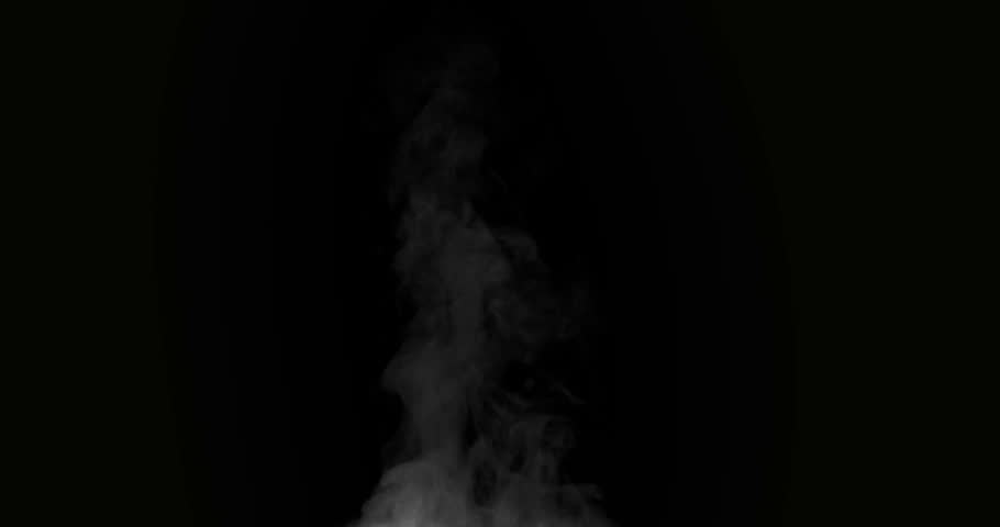 Boiling Steam in the Kitchen. White Steam rises from a large pot that is behind the scenes. Black background. Filmed at a speed of 120fps