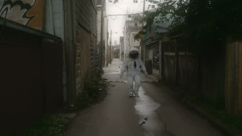 Astronaut walking down the street. 3D composited animation in 4K. | Shutterstock HD Video #28908460