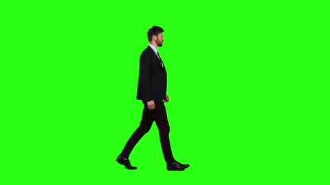 Man walks calmly down the street, he is happy. Green screen. Slow motion