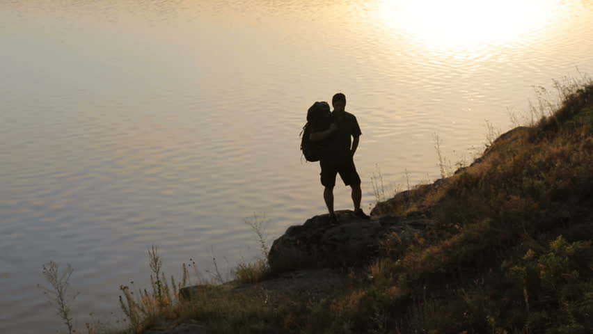 Man with hiking equipment walking in the hill | Shutterstock HD Video #28926514