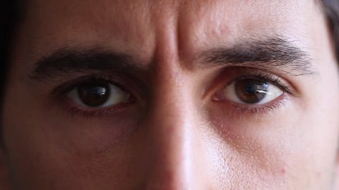Man closes and opens eyes. Man gives an expressive smile with eyes. Closeup of eyes and facial expression of man in his 30s