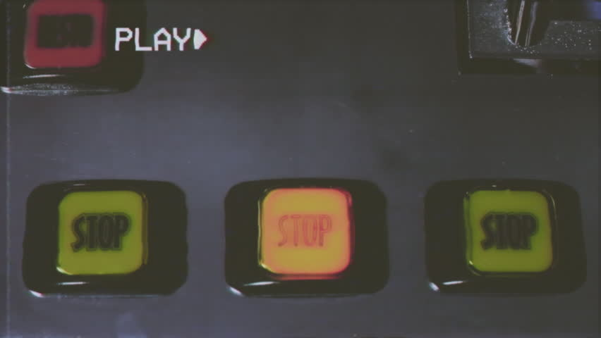 Fake VHS tape: the stop buttons of a slot machine (videopoker coin-based game).