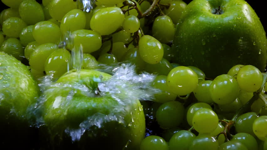 Amazing cleaning for fresh green apples and grapes in bunches, laying in shallow water in back-light. Excellent slow motion for vibrant intro in full HD. Shooting with high-speed, 240fps, camera. | Shutterstock HD Video #28985080