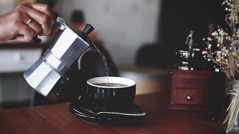 Coffe espresso from moka pot in coffee shop cafe cinemagraph