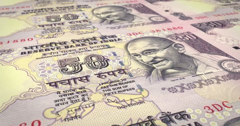 Series of banknotes of fifty indian rupees of the bank of the Republic of India rolling on screen, coins of the world, cash money, loop