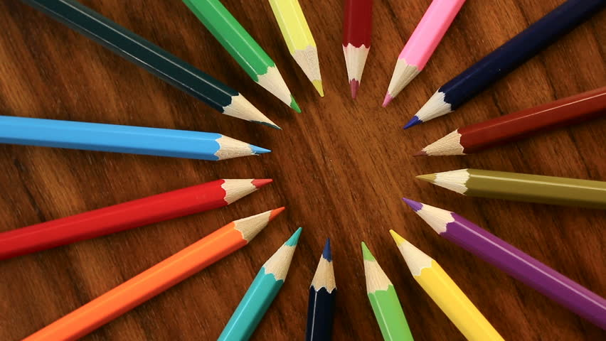 A lot of multicolored pencils revolve in a circle on a black wooden background. Concept office or school, knowledge day, the first of September. Video footage is spinning | Shutterstock HD Video #29052244