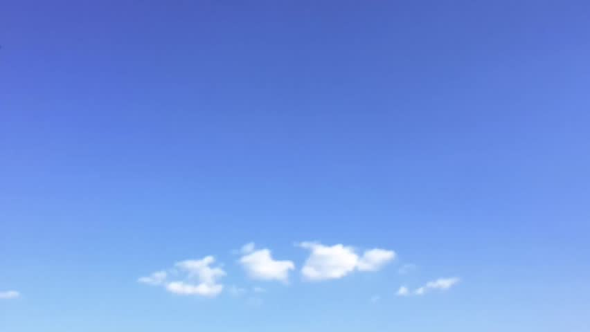 White clouds disappear in the hot sun on blue sky. Time-lapse motion clouds blue sky background. Blue sky. Clouds. Blue sky with white clouds. #29063560