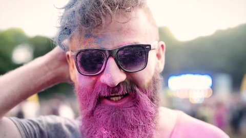 Pink color on the face of man