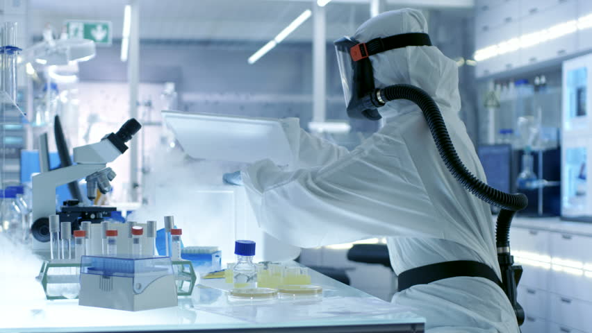 Medical Virology Research Scientist Works in a Hazmat Suit with Mask, She Uses Micropipette. She Works in a Sterile High Tech Laboratory, Research Facility. Shot on RED EPIC-W 8K Helium Cinema Camera. | Shutterstock HD Video #29109010