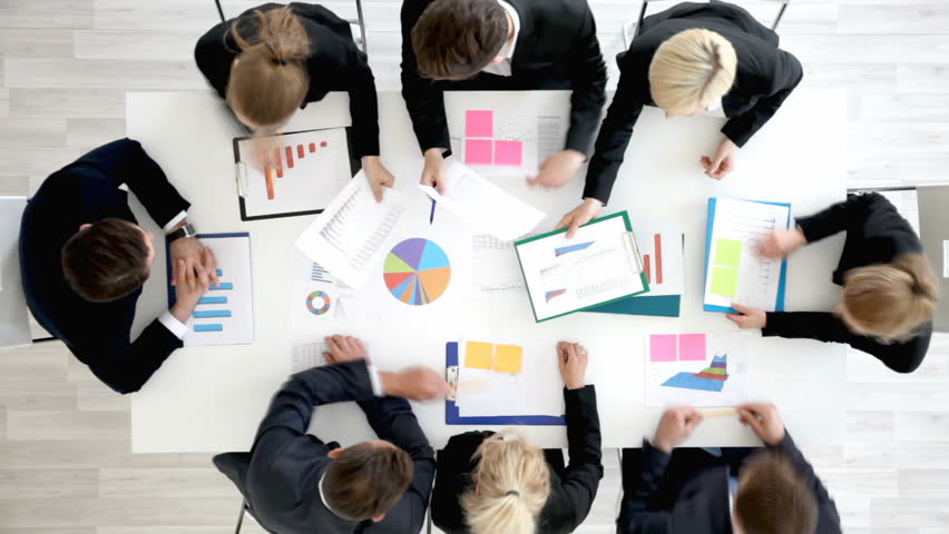 Business people work with statistics documents with tables and diagrams sitting around the table   Shutterstock HD Video #29115700