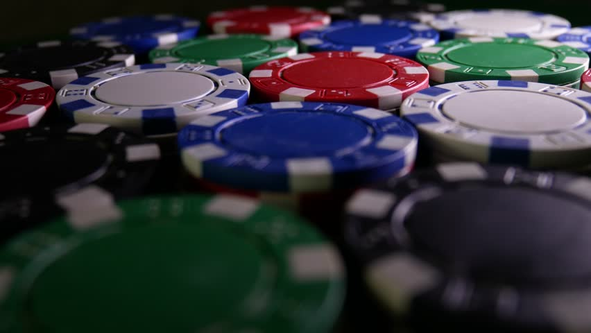 Poker Table With Poker Chips Turns In Casino. Poker Chips For Gambling Card Game