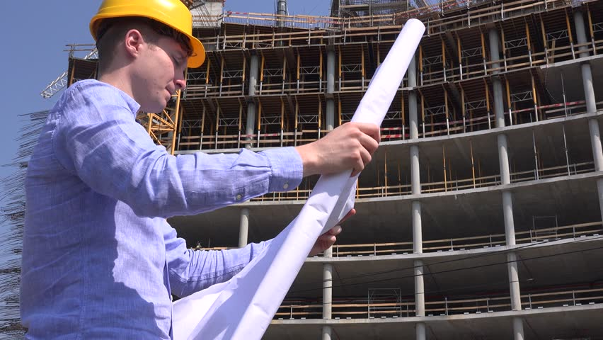 Architect profession reading blueprint construction plan builder angry business man outdoors builder investor check blueprints building plan sad 4k stock video clip malvernweather Image collections