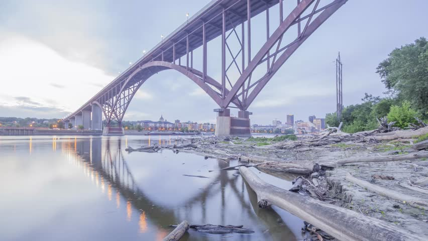 A Wide Angle Shot of the Smith Ave High Bridge Spanning the Mighty Mississippi River and St Paul Cityscape During Twilight 4K UHD Timelapse