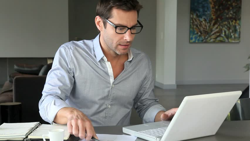 Home office worker using laptop computer