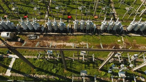 Aerial view Power plant, transformation station, cables and wires. High voltage electric power substation. Electrical power transformer in high voltage substation, 4K, aerial footage.
