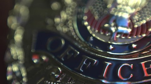 Police Officer Badge Macro with Siren Lights Flashing.