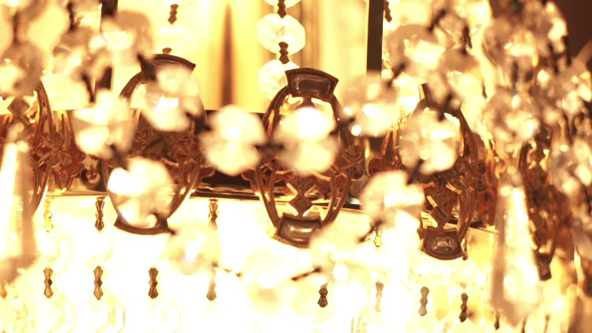 Luminous crystal chandelier. Close up crystal balls on a chandelier. Luxury crystal glass chandelier. Beautiful crystal chandelier in interior
