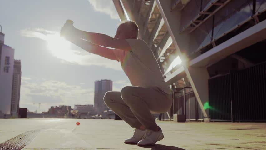 Senior sporty man doing squats outdoors #29229280