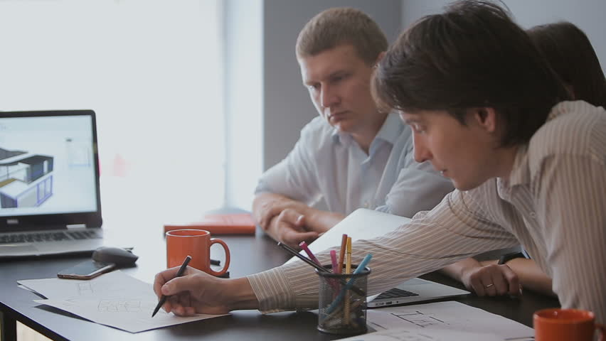Group of diverse people teamwork business meeting planning architect drawings future sustainable development with laptop computers and mobile device | Shutterstock HD Video #29243908