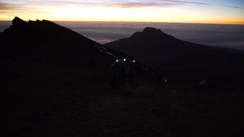 Group of people climbing Mount Kilimanjaro on the night with headlamp flashlight, Stella  Tanzania, Africa. Climbing the mount Kilimanjaro, Stella Point  Uhuru Peak