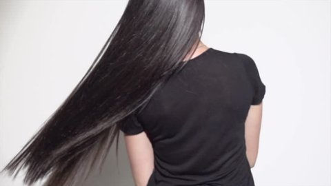 Beautiful long Hair. Beauty woman with luxurious straight black hair. Sexy brunette Model girl with Healthy Hair. Lady with long smooth shiny straight hair. Hairstyle, cure, extensions. 4K slow motion