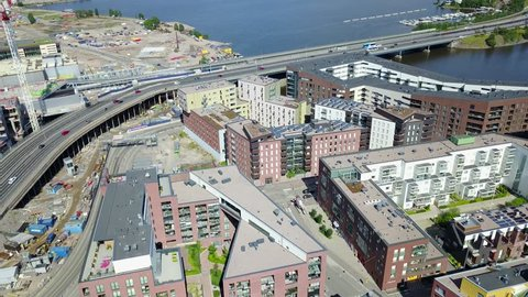 4K aerial view drone footage of Suvilahti old energy production industrial area with construction sites and city skyline, highways, roads and urban view in the capital of Finland, northern Europe