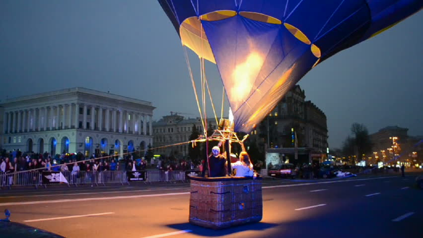 KIEV - OCT 20: Free Games Challenges extremal sport festival opening on October 20, 2012 in Kiev, Ukraine. Operator of air balloon open the gas-stove burner before it start flying.