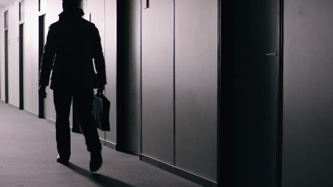 Office employee walking down corridor