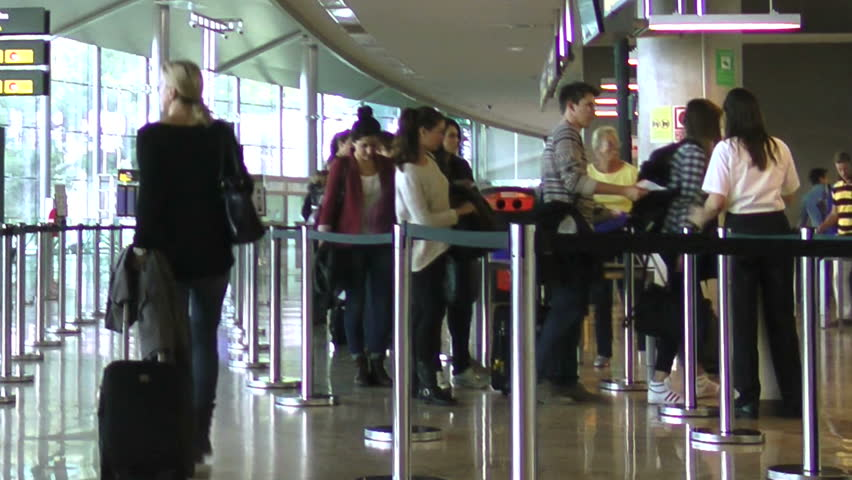 VALENCIA, SPAIN - OCT 24: Airline passengers starting their security check at the Valencia, Spain airport on October 24, 2012. 4.98 million passengers passed through the Valencia airport in 2011.