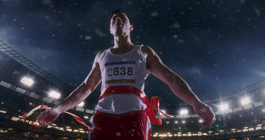 Male track and field runner crosses finishing line on the professional sports arena. The man is happy, smiling with his arms raised. Arena and people on it are made in 3D and animated.