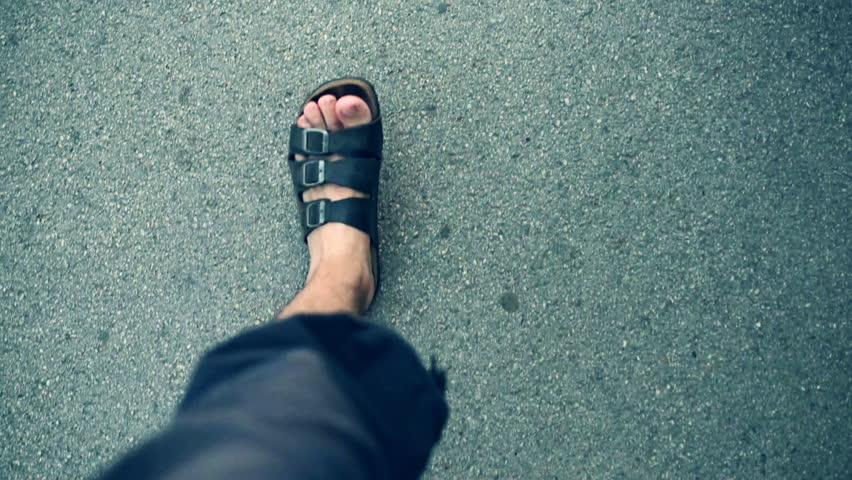 Man walking down the street, first person pov shot of male feet in leather slippers on asphalt road | Shutterstock HD Video #29523190