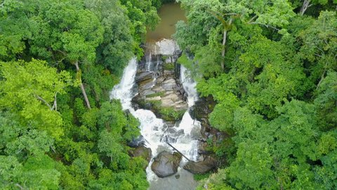 Aerial view of Sirithan waterfall with spray of water Splashing one of the famous waterfall at Doi Inthanon National Park mountain. Located in Chiang Mai, Thailand.