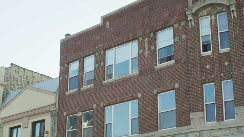 Day Hold Up Raked Right Top Floor Windows Small 3 Story Brick Building  Office Building,