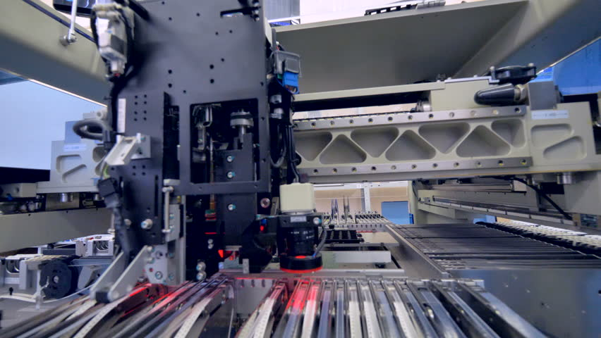 A circuit board production machine working at an electronic board plant.   Shutterstock HD Video #29620900