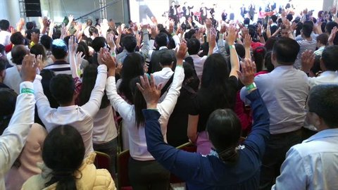 HO CHI MINH CITY, VIETNAM - JAN 10, 2017: People sing at the Christian conference held by Messenger International.