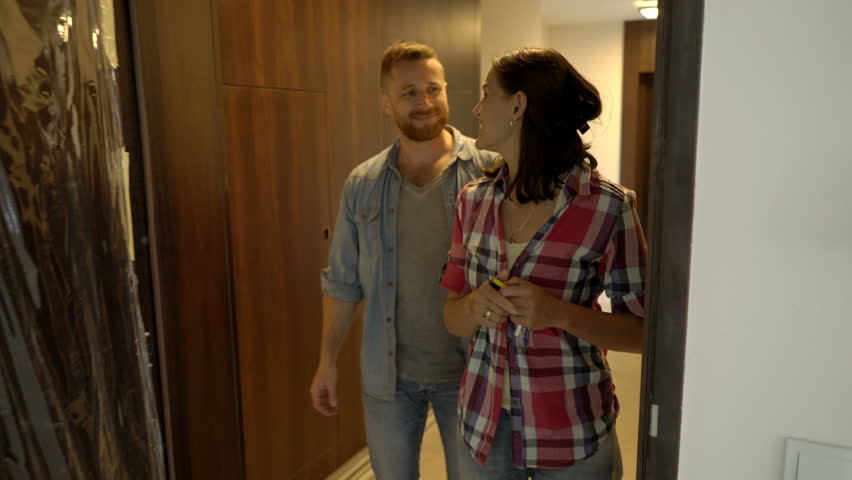 Happy couple walking to their new apartment, steadycam shot  | Shutterstock HD Video #29648770