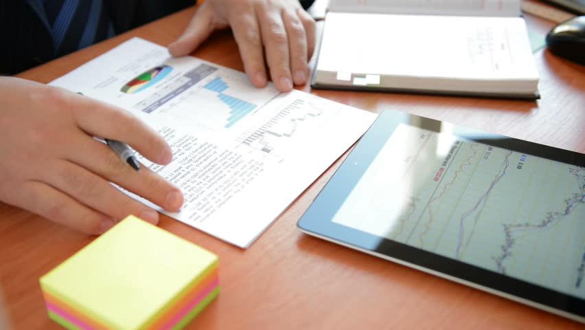 Businessman taking notes in a notebook. Full HD   Shutterstock HD Video #2965744