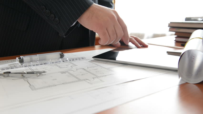 Architect using tablet pc in the work