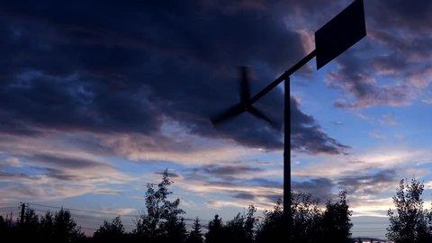 Beautiful sunset sky time lapse. Wind vane.