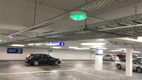 Car Parking lot sensors on ceiling, Indicator Light show Parking space unoccupied is green
