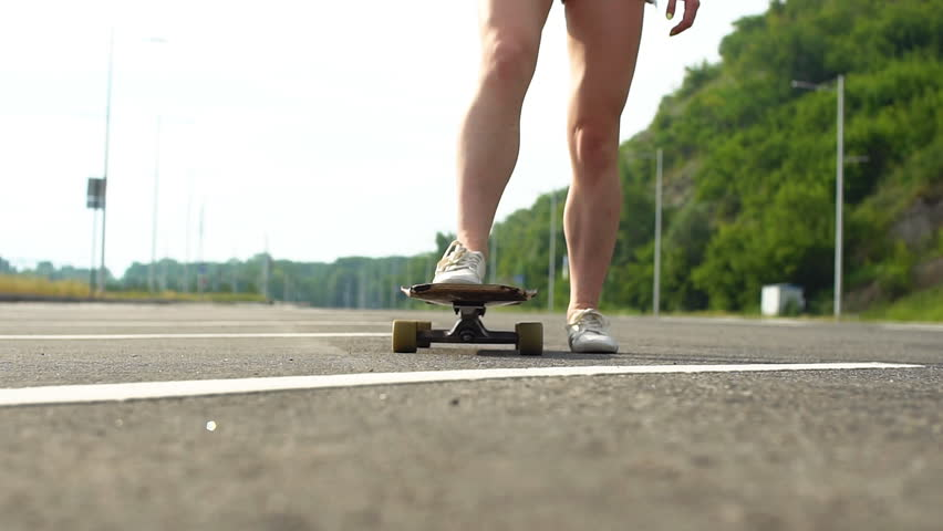 Young girl learns to ride on a longboard. Slow motion #29681560