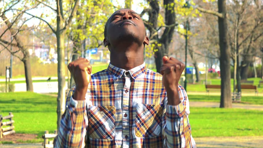 A young black man is angry in a park on a sunny day #29688310