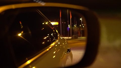See the police in the rear-view mirror with blue light