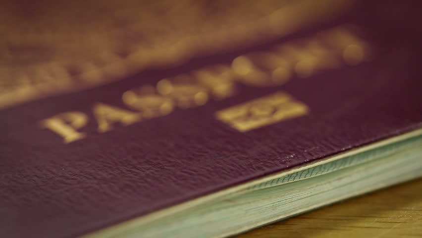 Flying over passport in extreme close up.
