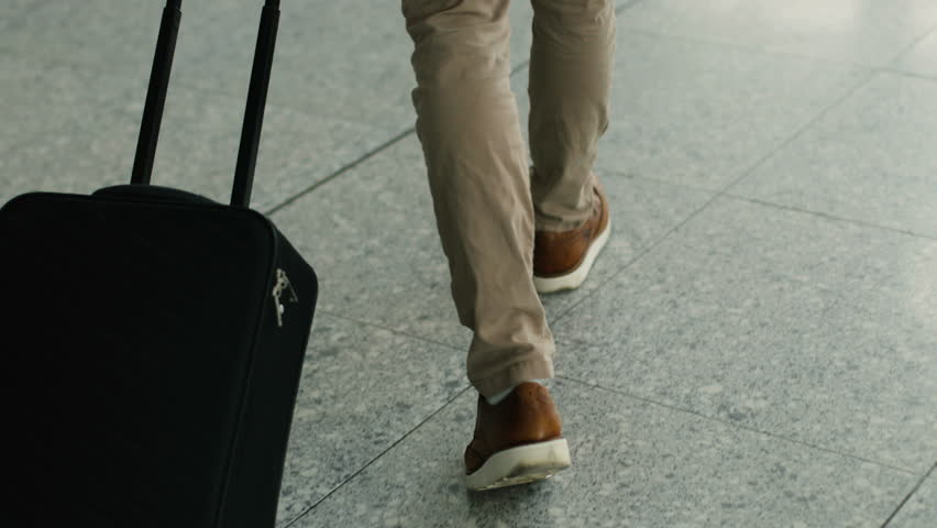 Close up shot of man legs with the baggage walking to the airport terminal. | Shutterstock HD Video #29743090