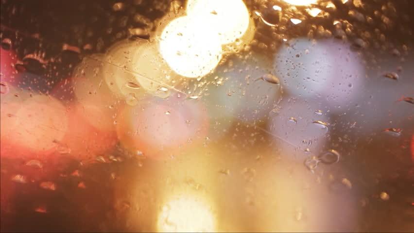 car window rain night background defocused in motion