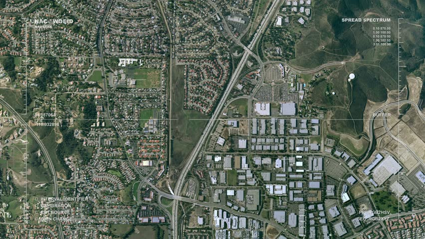 Aerial surveillance flyover of an urban, small city center. Reversible, seamless loop. Real-life geoimaging readout lexicon and labels.