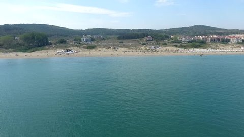 Parasailing in Black Sea in front of sandy beaches in Bulgaria Sozopol with wind of summer