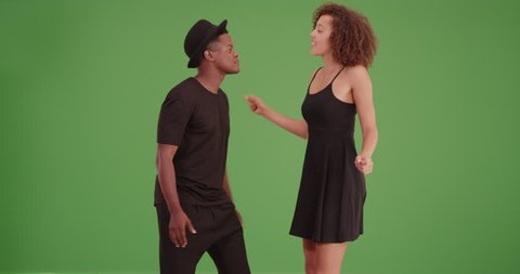 Black couple dances on green screen. On green screen to be keyed or composited.