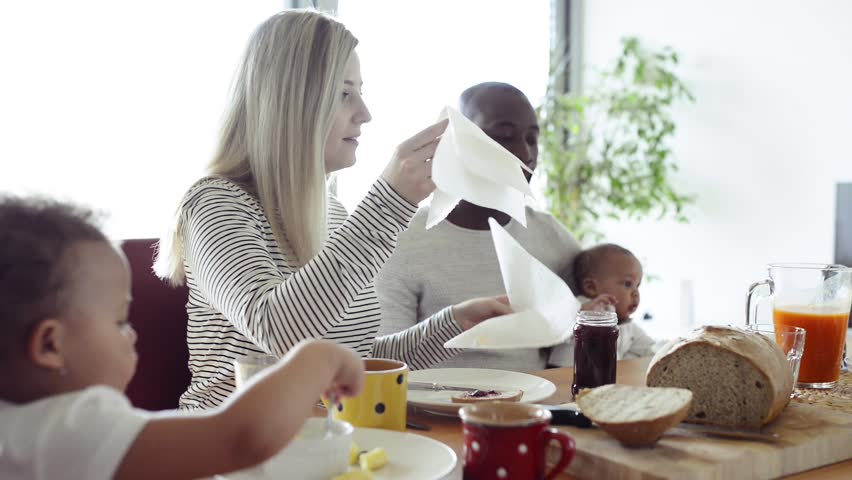 Young interracial family with little children having breakfast.   Shutterstock HD Video #29848765